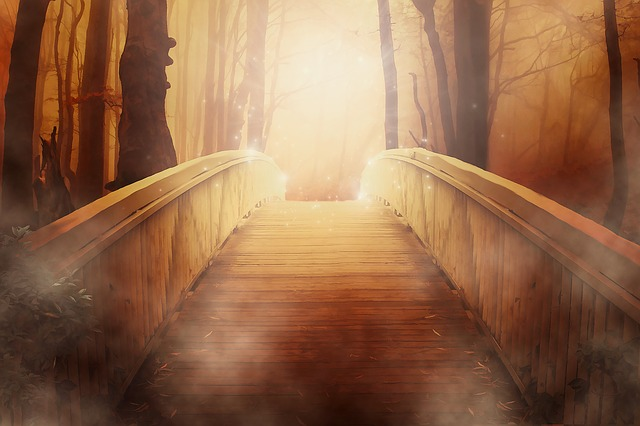 a bridge going up to a golden light