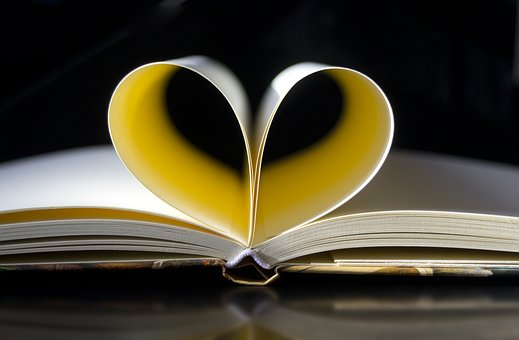 An open book with a heart on top