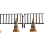 two steel blockades with an orange cone in front of each one.
