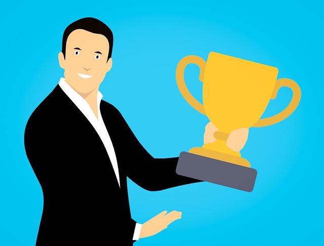 Businessman holding a brass trophy
