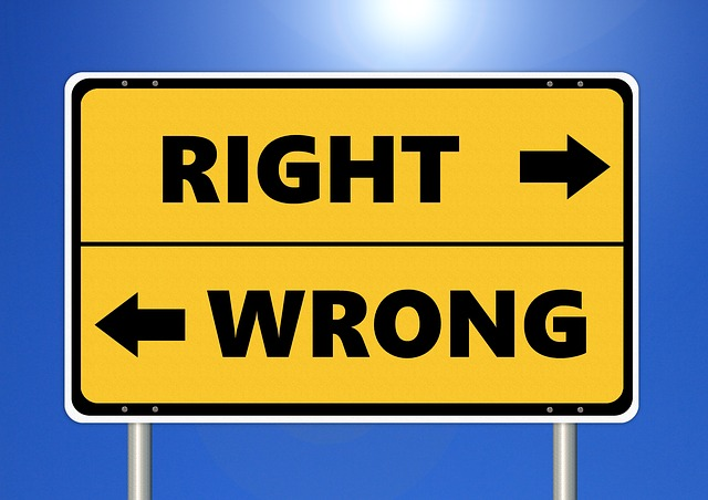 """Two arrows facing opposite direction with the words """"right"""" and """"wrong"""""""