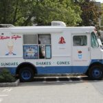 A white food truck that may include ice cream