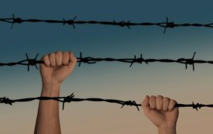 video game addiction two hands each holding a strand of barb wire