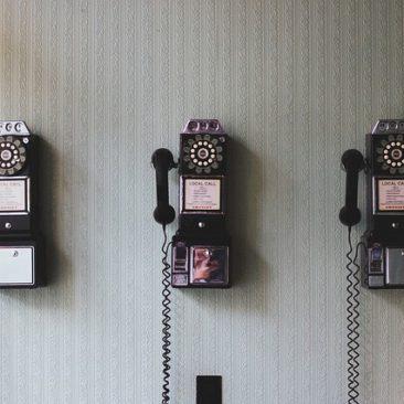 three old rotary phones