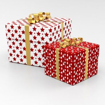 two gift boxes with bows