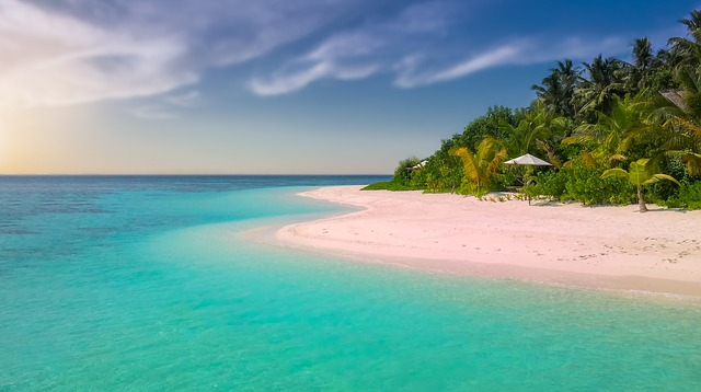 Isolated beach, blue water, pink sand
